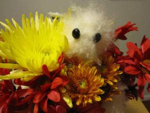 close-up of the Hug Monster in a bouquet of flowers